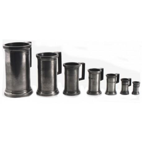 Set of 7 normalised measuring jugs