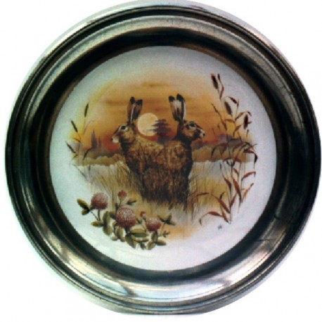 Pewter and faience plate with hare decor