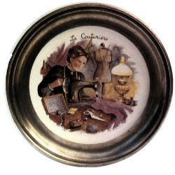 Pewter and faience plate with needlewoman decor