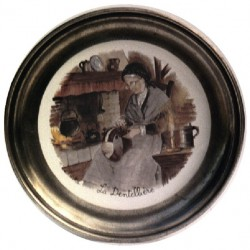 Pewter and faience plate with lacemaker decor