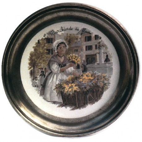 Pewter and faience plate with florist decor