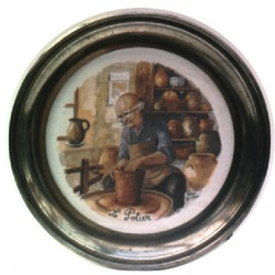 Pewter and faience plate with potter decor