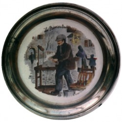 Pewter and faience plate with knife grinder decor