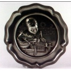Pewter plate with lacemaker decor