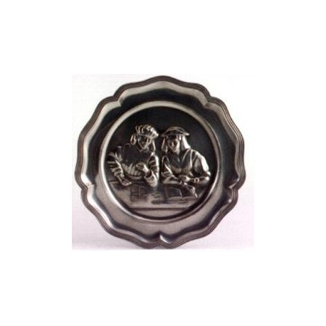 Pewter plate with gold weigher decor