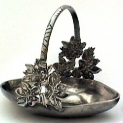 Small pewter basket with flower decor